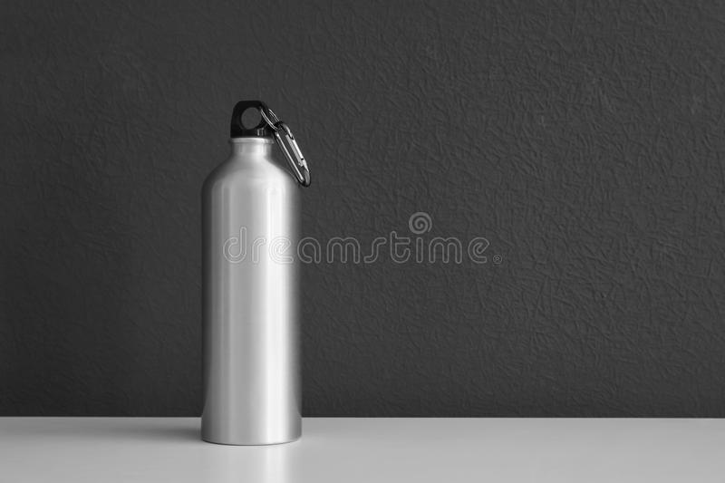 Aluminum water bottle for sports on gray background. Space for text stock images