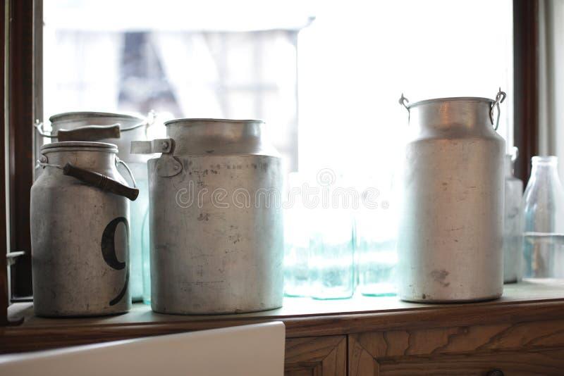 Aluminum watering (milk) can. Old vintage aluminum watering (milk) can and bottle stock photos