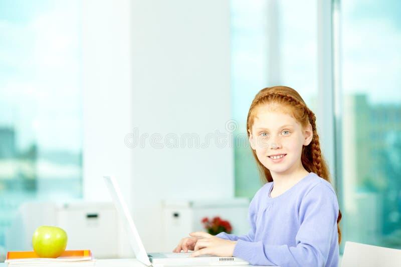 Alumno diligente foto de archivo libre de regalías