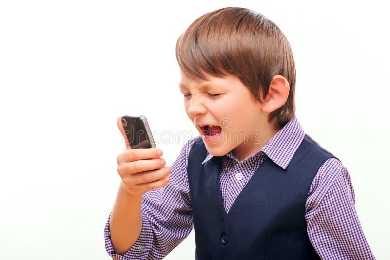 Alumno lindo en el grito del traje fotos de archivo