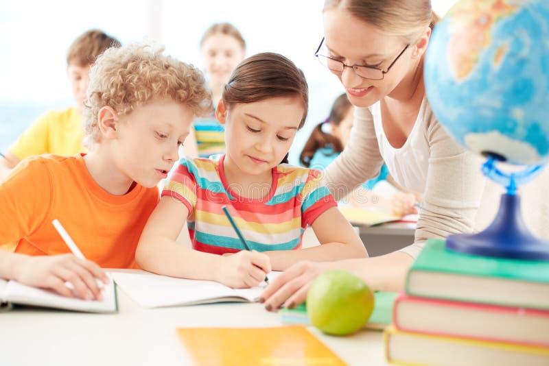 Alumnos en la lección imagen de archivo