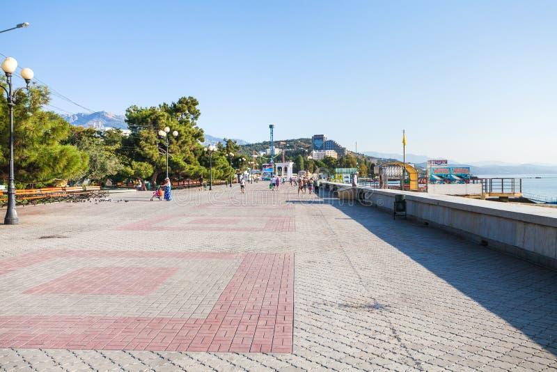 Visitor on Lenin Street Embankment in Alushta city stock image