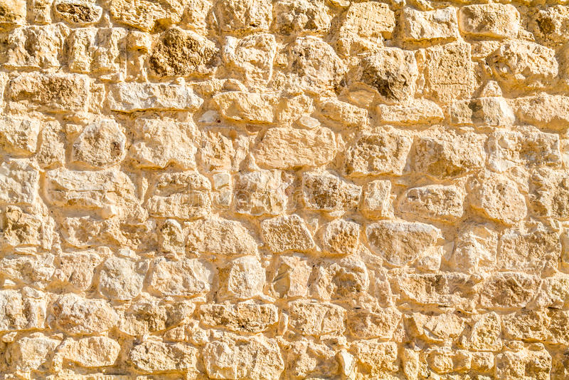 Alvenaria antiga, fragmento de uma parede fotografia de stock