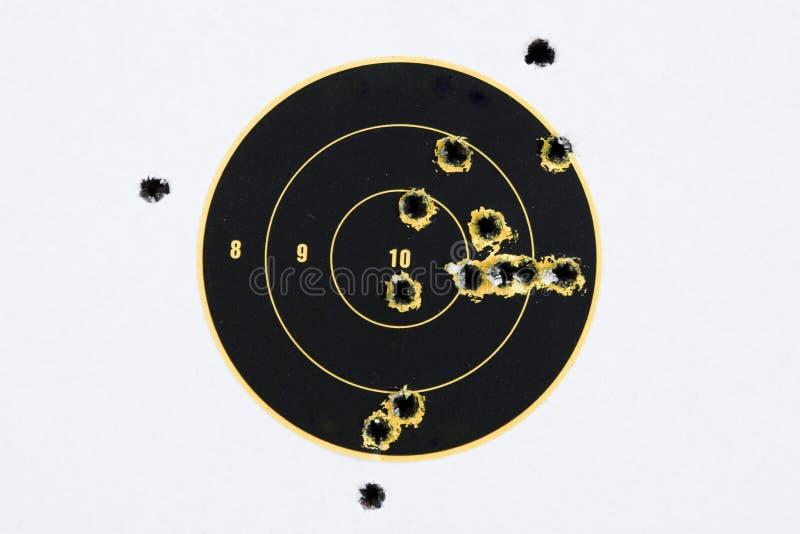 Alvo com buracos de bala imagens de stock