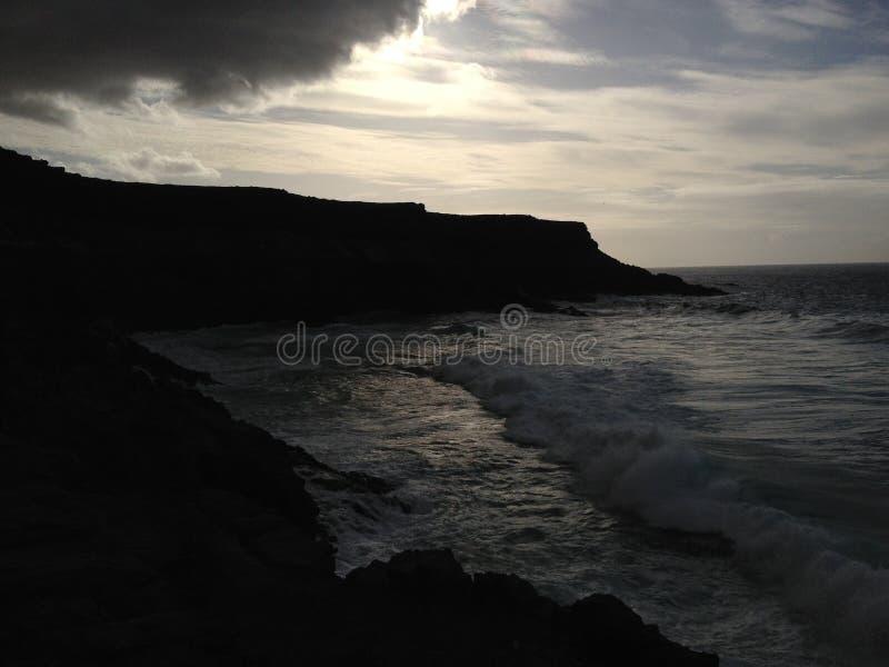 Alvorecer na praia de Fuerteventura foto de stock royalty free