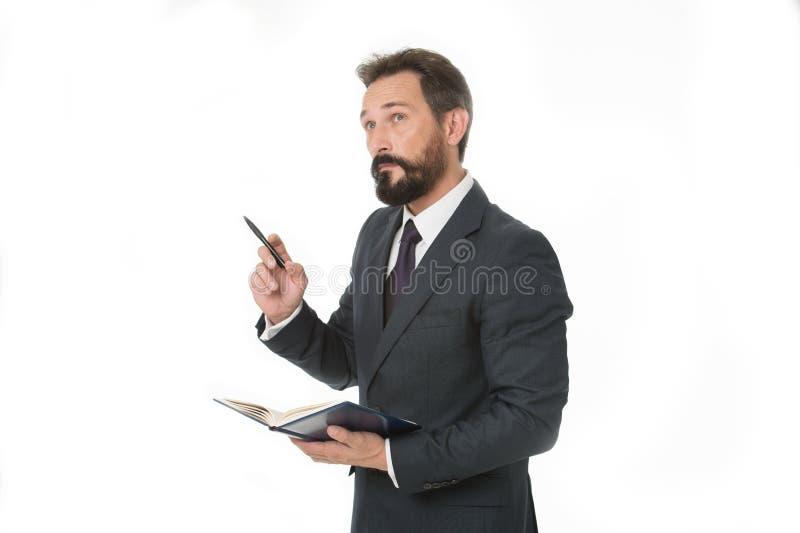 Alvorens de vergadering neerschrijft moet de informatie vervoeren en de behoefte vraagt Zakenman de greepblocnote van het plannin stock foto