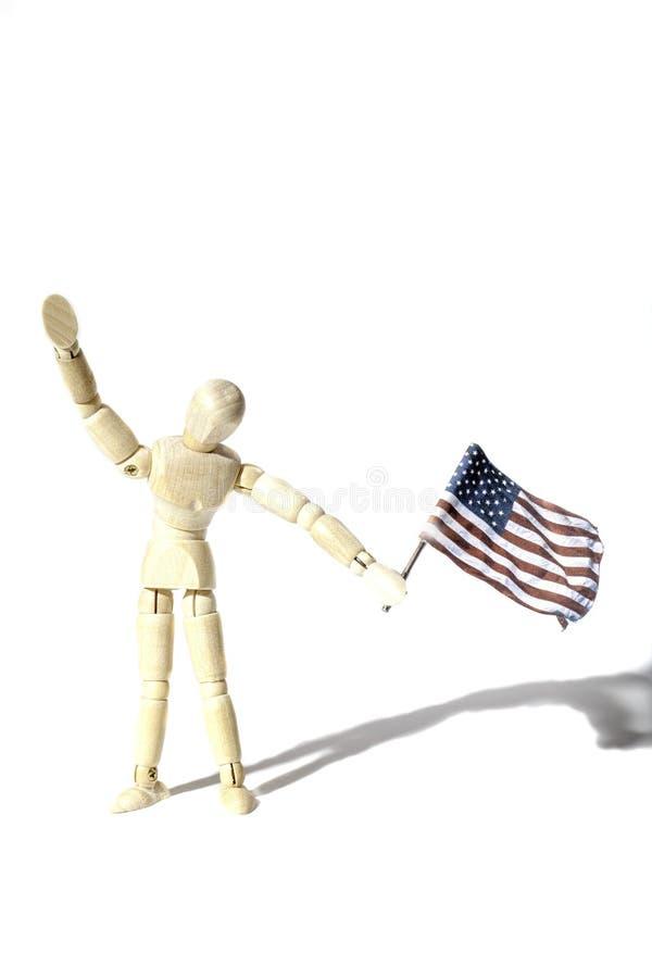Américain patriote moyen ondulant un drapeau des Etats-Unis photographie stock libre de droits
