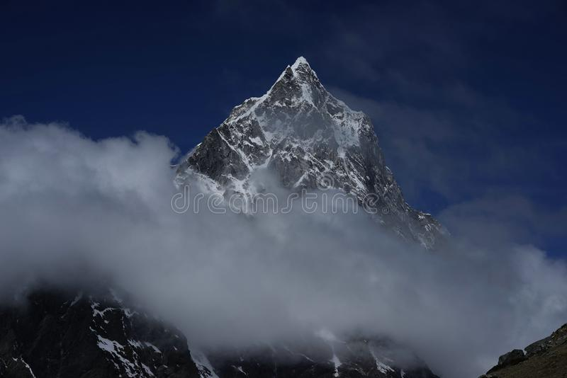 Ama Dablam in the clouds in Himalayas stock image