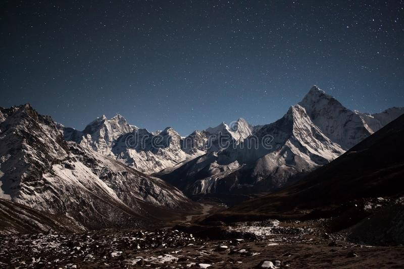 Ama Dablam mountain panoramic view on a starry. stock images