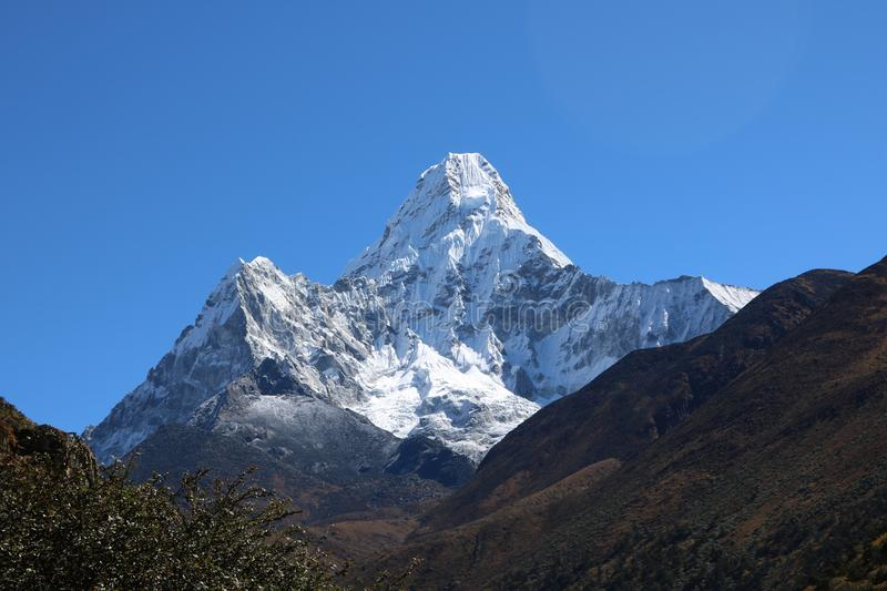 Ama Dablam is the third most popular Nepalese Himalayan peak in the world. Ama Dablam is a mountain attracts many climbers, some of them highly experienced stock photo