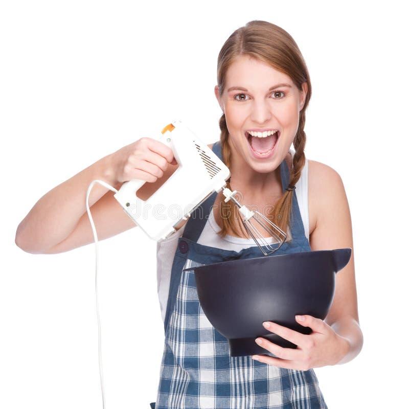 Ama de casa en cocina foto de archivo libre de regalías