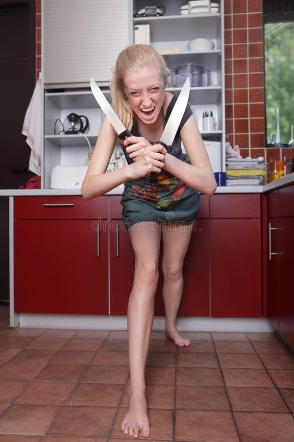 Ama de casa loca que se ejecuta amok fotos de archivo libres de regalías