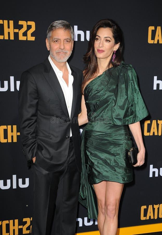 Amal Clooney en George Clooney stock afbeeldingen
