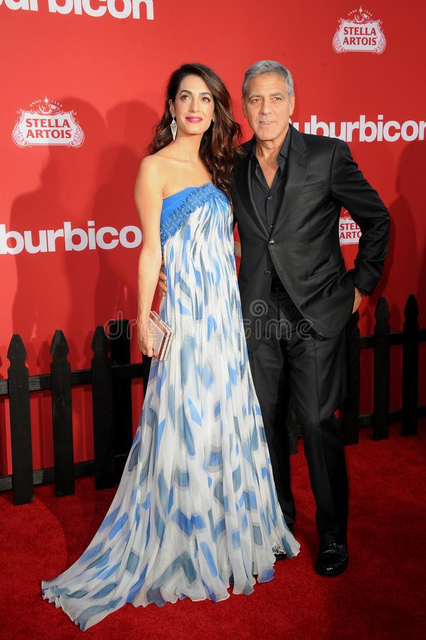 Amal Clooney and George Clooney. At the Los Angeles premiere of `Suburbicon` held at the Regency Village Theatre in Westwood, USA on October 22, 2017 stock images