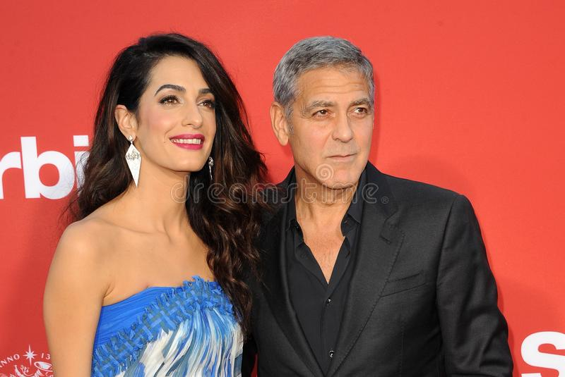 Amal Clooney and George Clooney. At the Los Angeles premiere of `Suburbicon` held at the Regency Village Theatre in Westwood, USA on October 22, 2017 stock photo