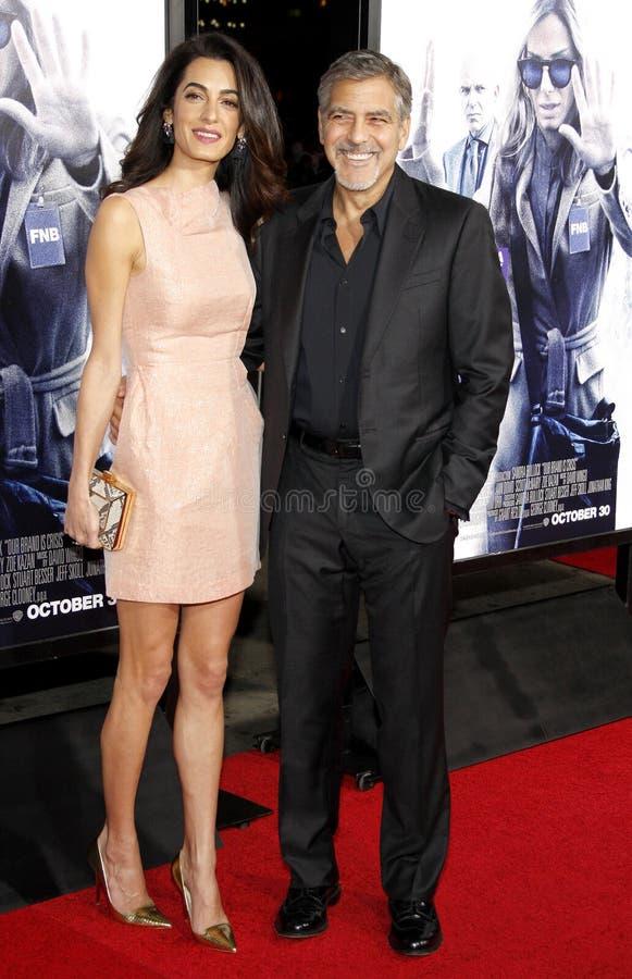 Amal Clooney y George Clooney fotografía de archivo