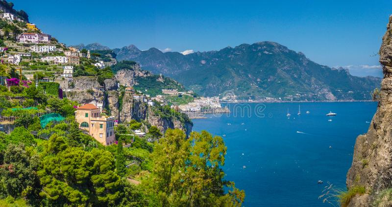 Amalfi Coast, Campania, Italy. Panoramic picture-postcard view of the beautiful town of Amalfi at famous Amalfi Coast with Gulf of Salerno on a sunny day with royalty free stock photos
