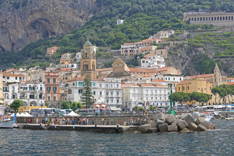 Dock at Amalfi. Amalfi, Italy - June 28, 2014: Tourists Waiting For Boat Transport at Dock Pier in Amalfi, Italy stock photo