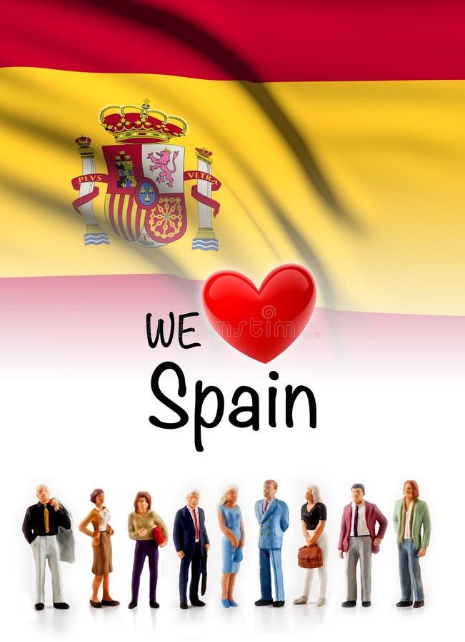 Amamos España, actitud del grupo de personas de A al lado de la bandera española fotos de archivo