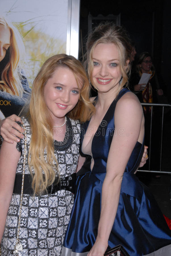 Amanda Seyfried,Kathryn Newton,The Dears. Kathryn Newton and Amanda Seyfried at the Dear John World Premiere, Chinese Theater, Hollywood, CA. 02-01-10 royalty free stock photo