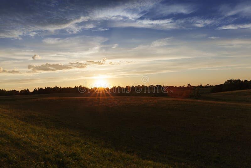 Amanecer de la puesta del sol fotos de archivo