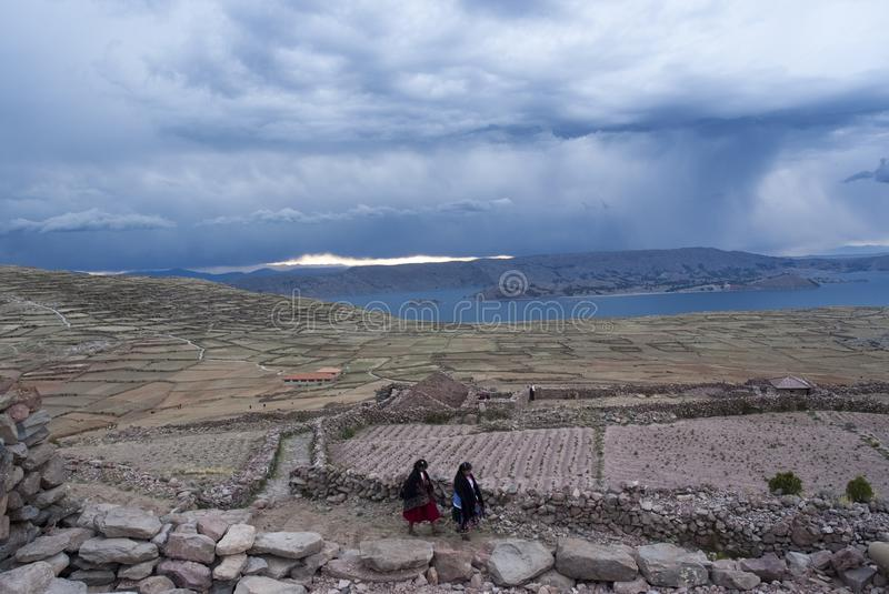AMANTANI ISLAND, PUNO: Woman with traditional dress down the hike in Amantani island. stock photo