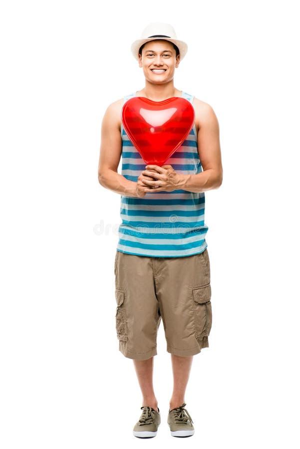 Amante del latino con il pallone di amore del cuore immagine stock