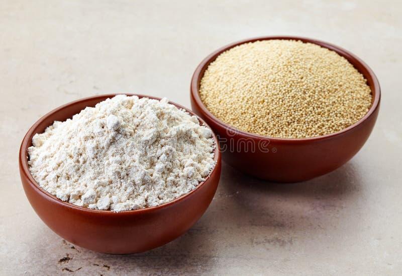 Amaranth seeds flour. Bowl of amaranth seeds flour and bowl of amaranth seeds. Gluten free stock photo