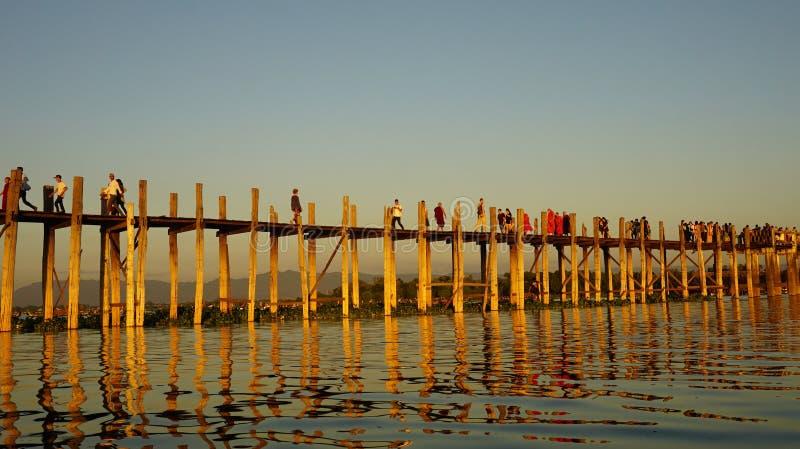 Amazing sunset through wooden bridge in Mandalay. Amarapura bridge - Beautiful sunset on Mandalay river through the longest wooden bridge stock photos