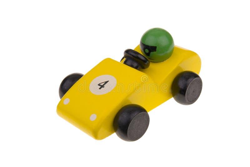 Amarele o carro de corridas de madeira do brinquedo fotografia de stock royalty free