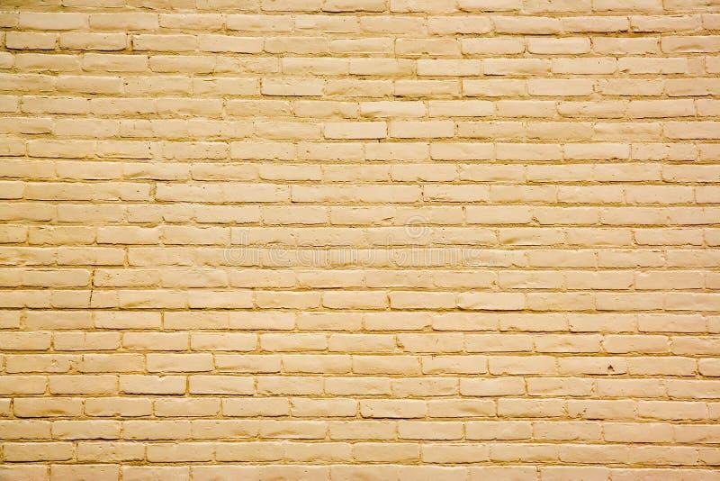 Amarele o fundo da parede de tijolo fotografia de stock royalty free