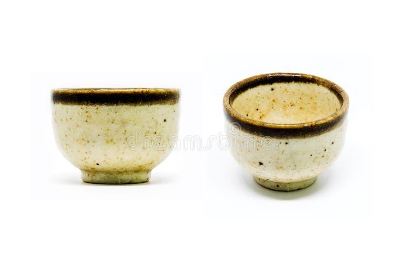Amarelo e marrom pequenos da cor do teste padrão da cópia do copo ou do copo de causa fotografia de stock