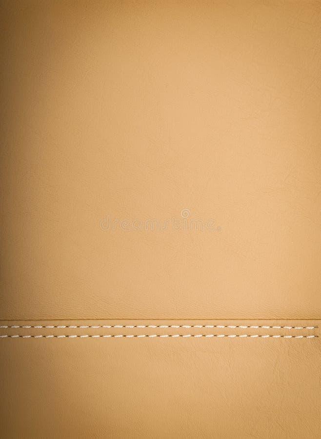 Amarelo ou luz - fundo de couro natural marrom imagens de stock