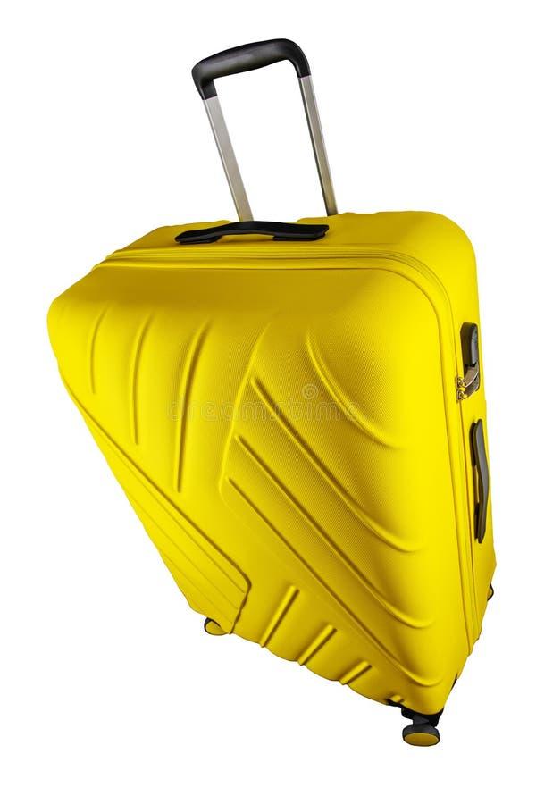 Amarillo de la maleta aislado en el fondo blanco, trayectoria de recortes imagenes de archivo