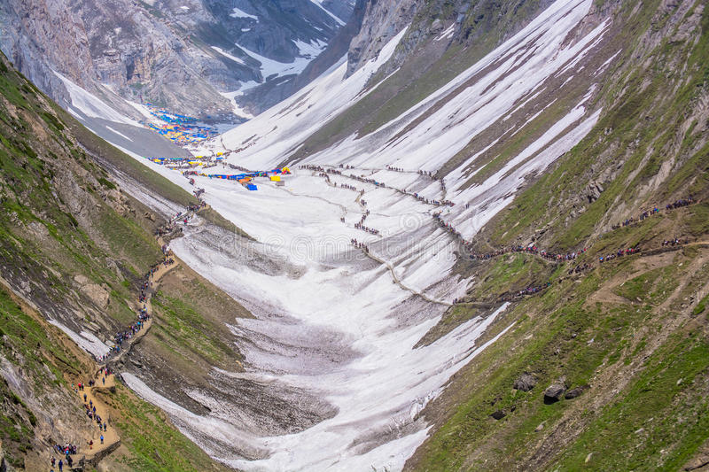 Amarnath pilgrims at holy cave. In june end when amarnath yatra starts the pilgrims proceeds to holy cave where shivlinga made of snow occurred every year in end stock photo