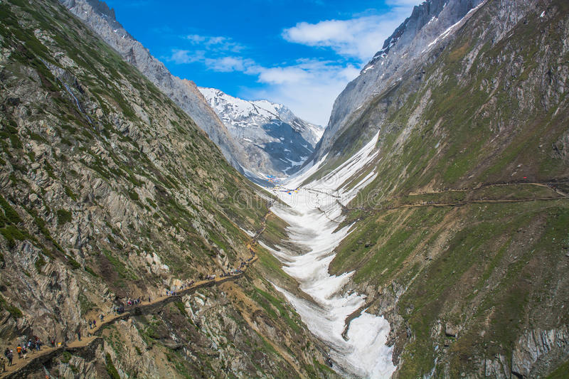 Amarnath yatra marg. In june end when amarnath yatra starts the pilgrims proceeds to holy cave where shivlinga made of snow occurred every year in end of june royalty free stock photos