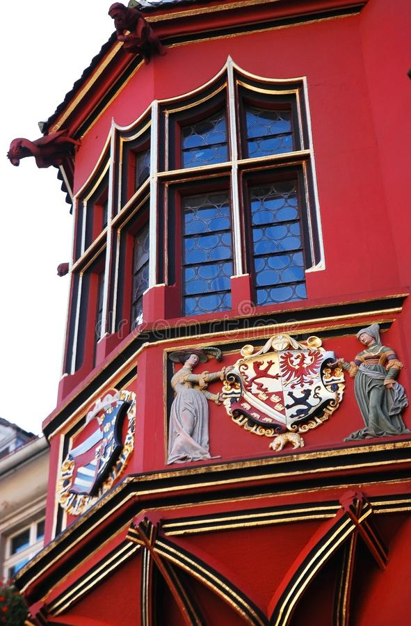 Details of Historical Merchants Hall facade, Freiburg im Breisgau, Germany. Amasing filigree facade decoration of the Historical Merchants Hall Kaufhaus in stock image