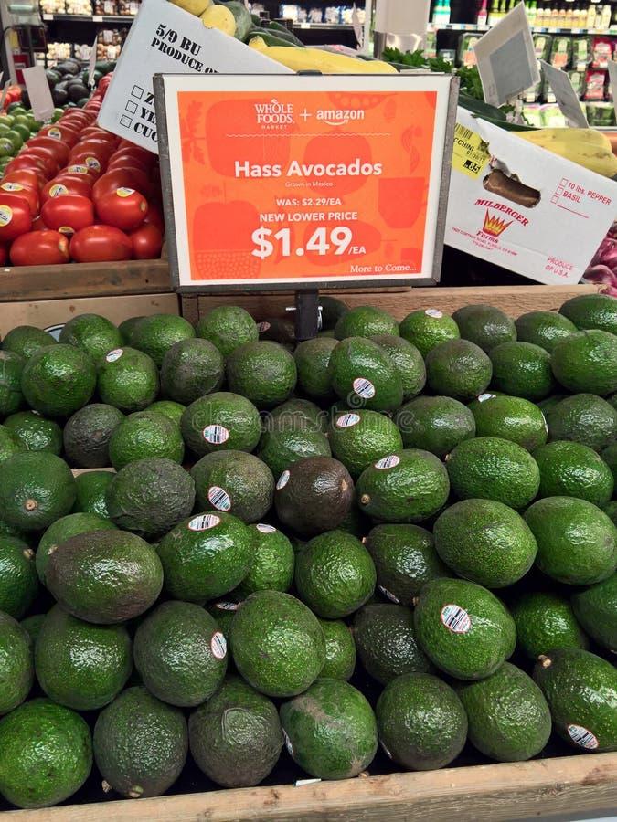 Amason-/Whole Foods sammanslagning - prisfallet royaltyfri foto