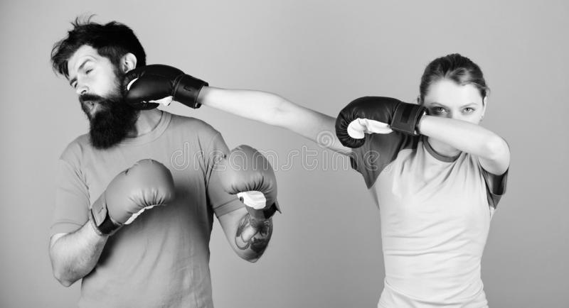 Amateur boxing club. Strength and power. Family violence. Man and woman in boxing gloves. Boxing sport concept. Couple royalty free stock photos