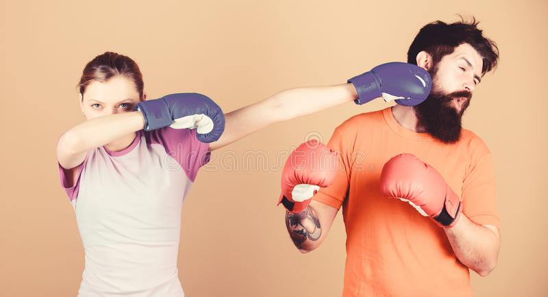 Amateur boxing club. Strength and power. Family violence. Man and woman in boxing gloves. Boxing sport concept. Couple stock photography
