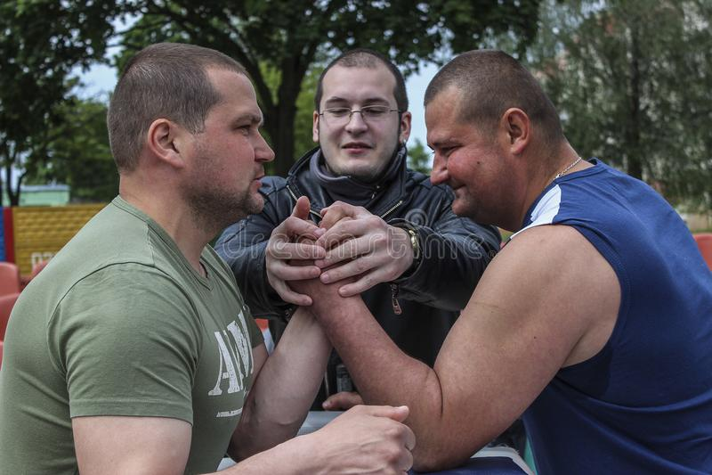 Amateur competitions on an armwrestling in the Gomel region of Belarus. Arm wrestling is a popular form of combat sports. During a match of the same hand the royalty free stock images