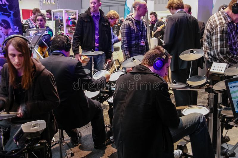 Amateur drummers play on Roland drums set in V-Drums royalty free stock photography