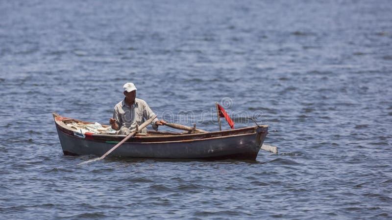 Amateur Fisherman on Rowboat stock image
