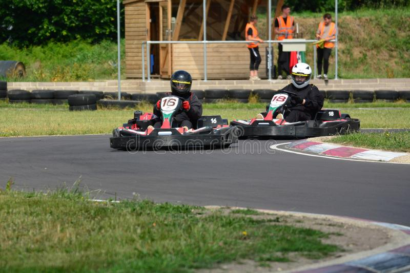 Go Karting Race. Amateur go kart racing. All fighting for the best position on the bend of the race circuit stock images