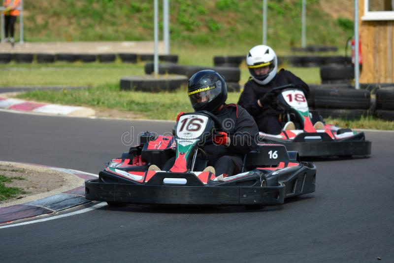 Go Karting Race. Amateur go kart racing. All fighting for the best position on the bend of the race circuit royalty free stock photos