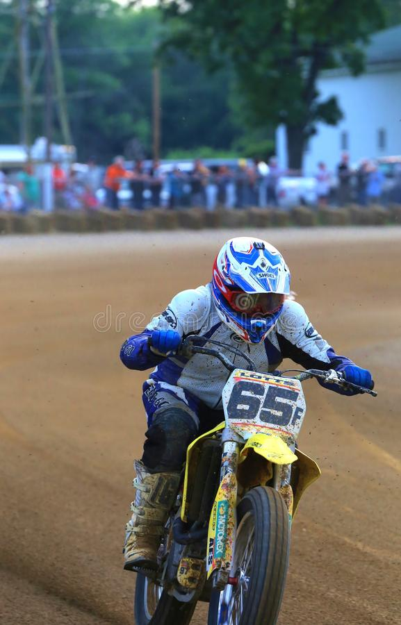 Amateur motorcycle racing. Motorcycle racer attempts to control the bike on the turn at the pro motorcycle racing event on the dirt oval track speedway, Ashland stock image
