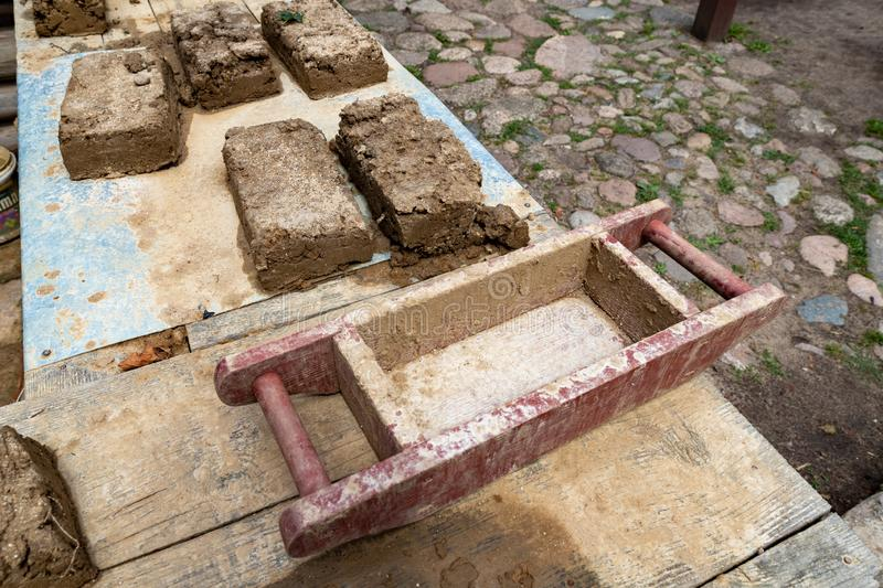 Amateur production of bricks. Ancient methods of making clay blocks stock photos