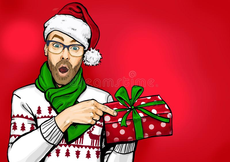 Amazed bearded man in glasses  and Santa hat with open mouth showing gift box. Emotions and advertisement. Surprised men. stock photo