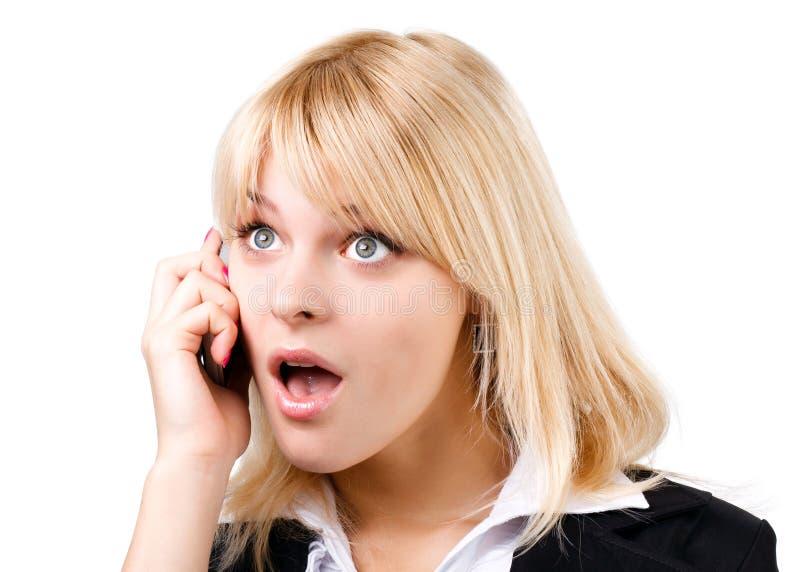 Amazed blonde girl talking on phone