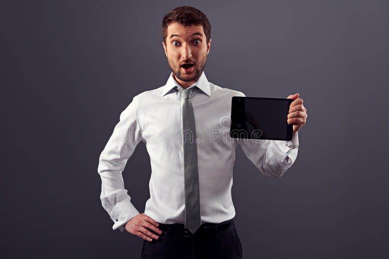 Download Amazed Businessman Showing The Tablet Pc Stock Photo - Image: 30003240